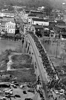 Marchers cross the Alabama river on the Edmund Pettus Bridge at Selma on March The civil rights marchers, eight abreast, are led by Martin Luther King Jr. They are fighting for voter registration rights for blacks. Black History Month, Black History Facts, Martin Luther King, Selma Bridge, Selma Alabama, Places In America, Civil Rights Movement, Thing 1, King Jr