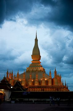 Wat Pha That Luang | Vientiane, Laos    Pha That Luang (Lao: ພຣະທາດຫຼວງ, IPA: pʰā tʰâːt lŭaːŋ, 'Great Stupa') is a gold-covered large Buddhist stupa on the eastern outskirts of Vientiane, Laos. Since its initial establishment suggested to be in the 3rd http://mozaikvoyages.com  http://mozaikvoyages.com/voyages-laos