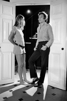 """Jane and Serge stood in the hallway, so close, but yet, so far a way -- all because of three words: """"I love you."""" Although Serge's posture displays more affection than Jane's posture, she is clearly demanding he say these words first, and more importantly, he say these words for real not haphazardly like most people say """"I am sorry."""""""