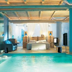 How relax would be fall asleep and woke up surround of a beautiful pool? The blue combine with bege accents give your bedroom a tropical touch.  #homedecorideas #luxuryhomes #masterbedrooms