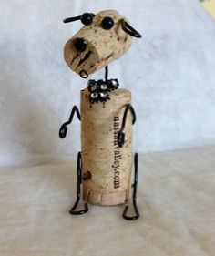 This is a one of a kind Winer- dog. It is made with an upcycled cork and other new materials. Each one has a personality and features a rhinestone