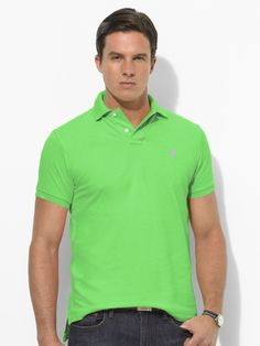Classic-fitting short-sleeved polo shirt in breathable, durable cotton mesh.    Notice how the logo changes color with the shirt.