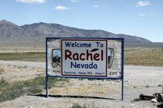 The sign welcoming visitors to Rachel, Nev., where space alien hunters gather every year and where residents now fear a white supremacist group that locals say is buying up property in the desert enclave.