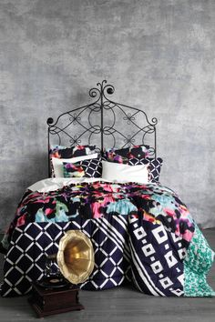 love the textured walls love everything about this! bed spread sooo cute