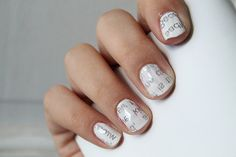I'm loving these newspaper nails! I find it easier to dip your nails in the rubbing alcohol rather than dipping the newspaper in it.