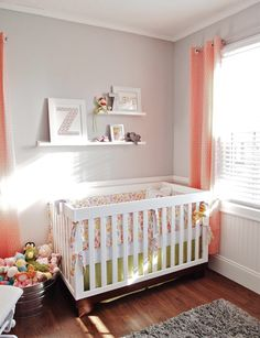 sweet girl nursery with gray walls