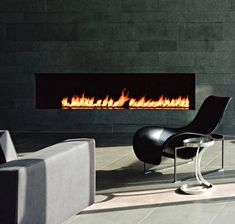 warm your room up with modern fireplace design: delectable schein loft by archi tectonics image modern fireplace wall is located near the light brown sofa and cool black chair