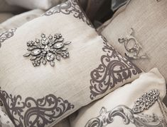 This little jewel of a pillow has a timeless design on each side created just to display and enhance our pins. Set includes our removable snowflake pin. Our vision is to create beautiful, neutral pill
