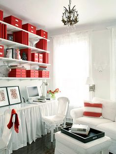 (Home Office) Instead of buying a custom-built desk, build your own. To make a small room live bigger, designate an entire wall to be your desk area. Install sliding shelves to keep your printer, scanner, and paper products out of sight. Consider finishing your desk with privacy curtains to disguise what's under your desk. ALSO... I LOOOOOVE THE RED!