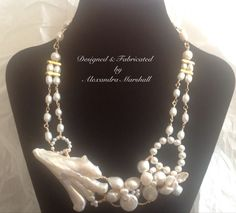 Stunning one of a kind freshwater pearl necklace with an asymmetrical design accentuating a giant natural Biwa pearl. Designed and fabricated by Alexandra Marshall for Petite Bijoux Chic Wearable Art. $189.