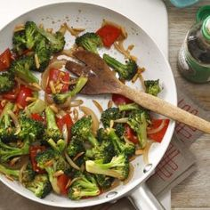 Almond Vegetable Stir-Fry Recipe -While broccoli florets and chunks of red pepper give this dish plenty of color, it's the fresh gingerroot, garlic, soy sauce and sesame oil that round out the flavor.                                       -Mary Relyea of Canastota, New York