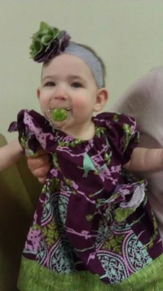 Made a pretty dress and matching flower headband for Samara pattern came from littlelizardking.com great pdf patterns
