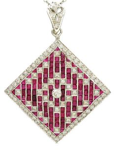 Brilliant Diamond and Ruby Pendant/Pin, set in 18K white gold with beautiful diamond bale. Set in a striking geometric pattern. USA 1930's
