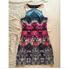 Fuchsia Mirror Print Dress REPOSHING my purchase. This was too tiny for me or my daughter. True XS! This dress is flawless. Original posher said she wore it once. It's a multicolored dress made of smooth and stretchy materials w a back zipper accent. Price is negotiable. Lulu's Dresses Midi