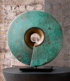 Verde Coil by Cheryl Williams. The simple yet striking form of this wheel-thrown ceramic sculpture has great presence. After the second firing, Williams applies copper paint and finishes with a turquoise patina creating a remarkably textured surface. Mounted on a steel base (included). Each is unique and will vary.