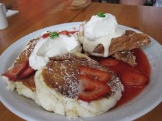 I love this place. I dream about their food.  Cream Pot (Waikiki, Oahu) - Souffle Pancakes and Strawberries