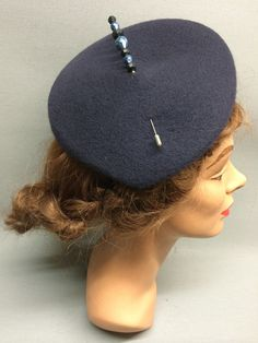 This felt fascinator, The Jasmine, has a slanted crown and its quirky shape projects a subtle sense of individuality. Attached with elastic and trimmed with a beautiful vintage hat pin. Colour: Navy #Fabhatrix #Edinburgh #Grassmarket #felt #fascinator #occasion