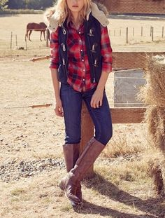 Fall's go-to outfit: boots, blue jeans, plaid shirt and a cozy vest.