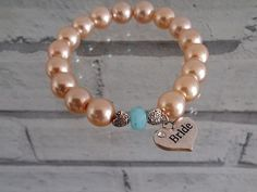 Check out this item in my Etsy shop https://www.etsy.com/listing/228755197/champagne-glass-pearl-and-aquamarine