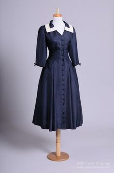 A timelessly beautiful late 1940s navy blue day dress with bracelet-length sleeves and white bordered collar. #vintage #1940s #dresses #fashion