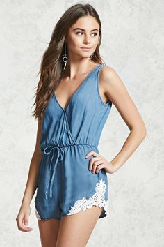 A chambray woven romper featuring a sleeveless cut, surplice neckline, elasticized drawstring waist, crochet trimmed hem, and a buttoned keyhole back.