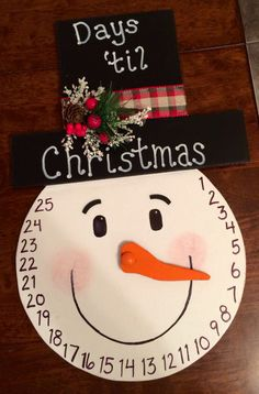 Snowman Advent Calendar. One of my personal favorites. Made of wood with a movable wooden nose.