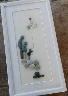 Pebble art Family 3   You see a beautiful family, mother, father and baby girl .. All eyes are toward the youngest and sweetest girl .. This pebble art has a beautiful composition, perfectly integrated into the natural color of the stone .. to dress fluttering mother, the girl is leaning, holding balloons .. This beautiful image was created from sea pebbles from the beaches of the Adriatic ..  Beautiful family gift, housewarming gift, wedding anniversaries, birthdays, holidays, etc .. The…