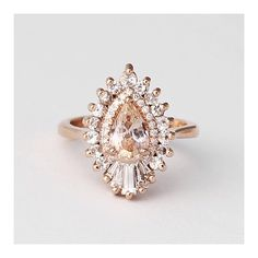 This peach sapphire and diamond delight by @heidigibsondesigns