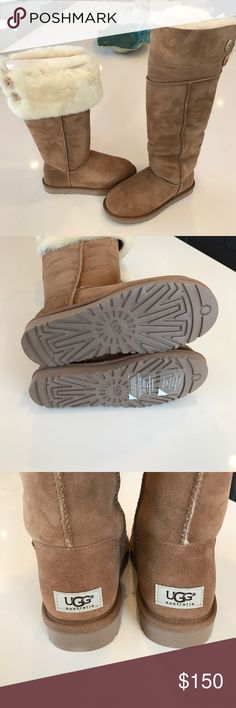 New! Over the Knee Bailey Button UGGS Brand new Bailey Button UGG boots. Over the knee or folds down shorter. Size 6. Guaranteed genuine. Bought for my granddaughter's birthday but I got the wrong size & had them too long to get a refund. UGG Shoes