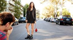 Ashley Madekwe: Love this all black look with the tough boots and the mini red bag.