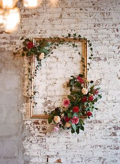 Make your Photo Booth from a frame with a floral arrangement. Inexpensive and spells Holiday time.