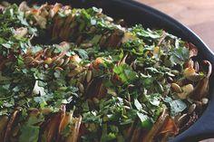 Sweet potato gratin with goat cheese, Thai chilies, pepitas, and cilantro.