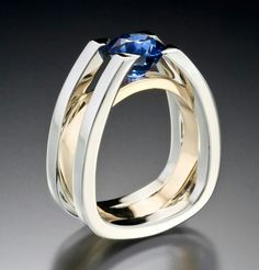 Adam Neeley Fine Art Jewelry - Forte - Strength and structure. This architecturally inspired Men's ring suspends a carat royal blue sapphire in white gold and yellow gold. Modern Jewelry, Jewelry Art, Gold Jewelry, Jewelry Rings, Unique Jewelry, Vintage Jewelry, Jewelry Accessories, Fine Jewelry, Jewelry Quotes