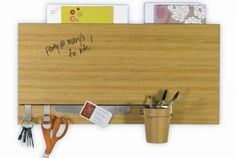 Organize mail and papers, plus keys, sunglasses and writing utensils and leave reminder messages on the dry erase panel.