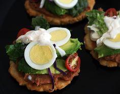 "El Salvadorean Enchiladas.  ""Unlike Mexican enchiladas, Salvadoran enchiladas feature crisp fresh ingredients layered over warm tortillas and refried beans."""