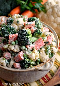 Winter Vegetable Salad - Combined with a creamy and zesty dressing, this salad is a really delicious way to enjoy fresh carrots, broccoli and cauliflower! Gotta take out the carrots though