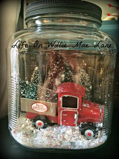 Snow globe on be DIY. square jar with truck & bottle brush trees Christmas Red Truck, Christmas Jars, Primitive Christmas, Country Christmas, Christmas 2019, Winter Christmas, Vintage Christmas, Christmas Decorations, Christmas Projects
