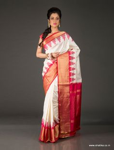 A feather in the cap of our new break free collection of Patola silk sarees that are dedicated to the wonder women who chase their dreams is Bhagyashri White and Red Temple Border Designed Patola Silk Saree. Woven by master weaver Gopal Salvi, it is yet another marvel from the Salvis of Patan, Gujarat.