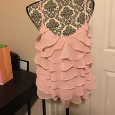 Candies Medium light pink spaghetti strap blouse Perfect for spring time!  A beauty! Always so many good looks in this.  Straps are adjustable.  Sheer top with second layer to cover any imperfections.  Great for dates and work! Tops Tank Tops