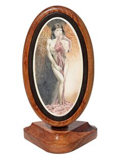 """""""Lady Icarus"""" Scrimshaw on Ancient Mammoth Ivory by Karen Reno. Outstanding work by Reno on this one. Love the color in the wings that compliment the draping fabric. The stand is simply a work of art in itself. Size: 3 3/4""""W x 3""""D x 5 1/2""""H  Price: $2500.00  -- on ScrimshawGallery.com #scrimshaw"""
