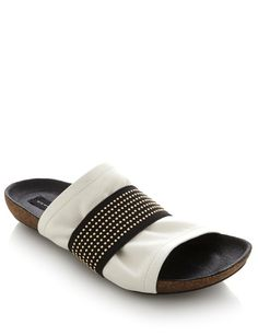 Rock these studded @SteveMadden slip-on sandals this summer! Pair with a casual look for the beach or dress up for a stylish night on the town.