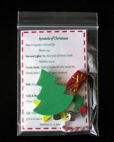 {Miniature Christmas Symbols Kit}      I found all these minis at Hobby Lobby and Michael's. Typed up, printed, and laminated a small card that briefly tells  about what each Christmas symbol means and put it, along with the symbols, into a little ziploc baggie. You could attach one of these tiny kits onto a plate of goodies and it would make a thoughtful gift for neighbors and friends!
