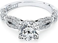 Tacori Pave Ribbon Diamond Engagement Ring: Your choice of a center diamond hovers over the intricate ribbon twisting pattern of the foundation. The diamonds on the ceiling of this amazing Tacori engagement ring seem to fold over the edge like a gentle lace-like blanket. The ring exudes a soft and feminine sensation for a lifetime of love and happiness.