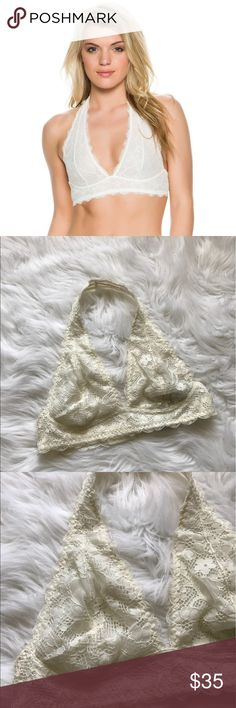 Free People Galloon Lace Halter Bra NWT lace bra. Elastic throughout and clasps on the back. Tag says the color is ivory. Free People Intimates & Sleepwear Bras