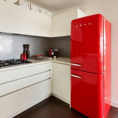 Cool red fridge freezer in an off white kitchen