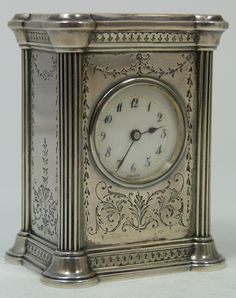OLD WILLIAM KERR STERLING SILVER MINATURE CLOCK  Antique sterling silver miniature clock constructed by the William B. Kerr Company