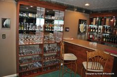 Home Bar (Tony calls his Man Cave) in Frankfort. He knows by heart every bottle in this collection.  Left side.