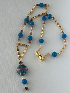 Blue European glass bead necklace, gold tone chain and bead necklace by LunicaDesignJewelry on Etsy