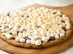 Grilled Chocolate Chip S'more Pizza Recipe from Betty Crocker 1 package (16 oz) Pillsbury® Ready to Bake!™ refrigerated chocolate chip cookies 1/2 cup small pieces graham crackers 1/2 cup small pieces milk chocolate candy bars 2 cups miniature marshmallows