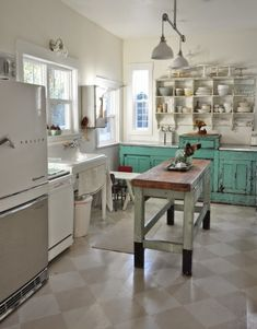 Beautiful vintage look kitchen with turquoise counters